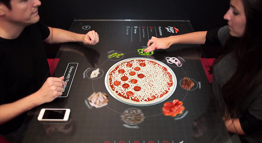 Pizza's met touchscreen samenstellen